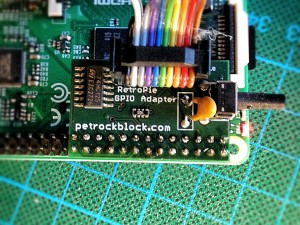 Ribbon cable connected to revision 2.X of the RetroPie GPIO Adapter.